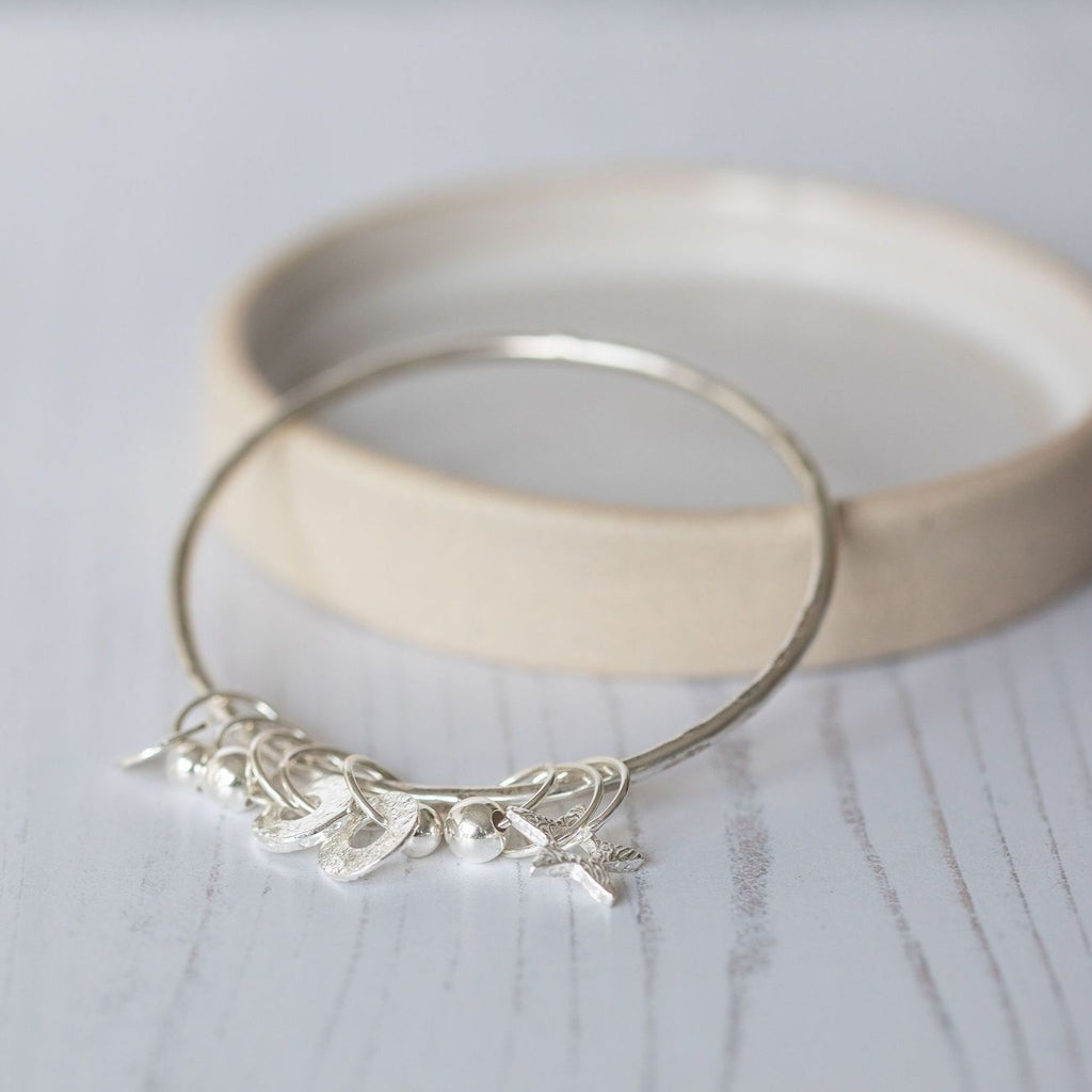 sterling silver charm bangle handmade by Lucy Kemp Jewellery