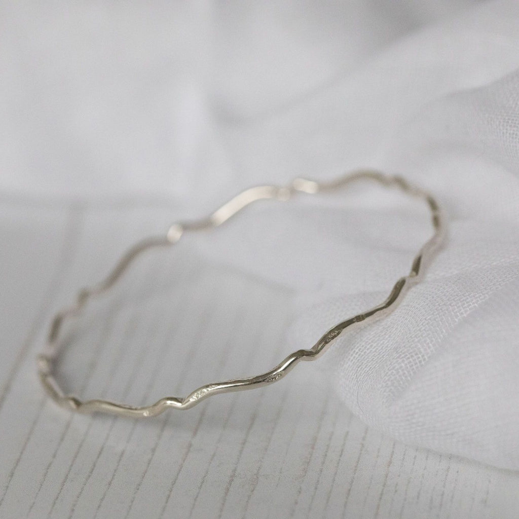 sterling silver scroll bangle handmade by Lucy Kemp Jewellery