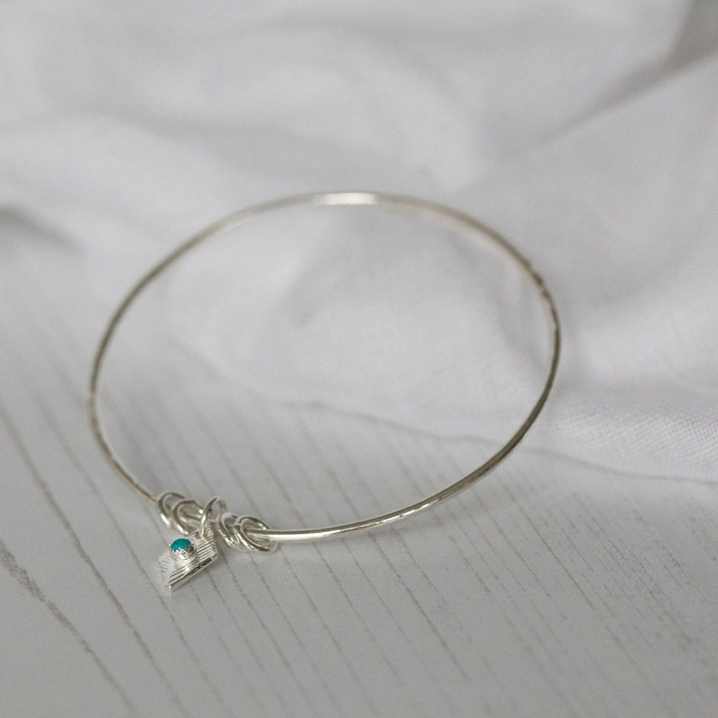sterling silver and real turquoise diamond charm bangle by Lucy Kemp Jewellery