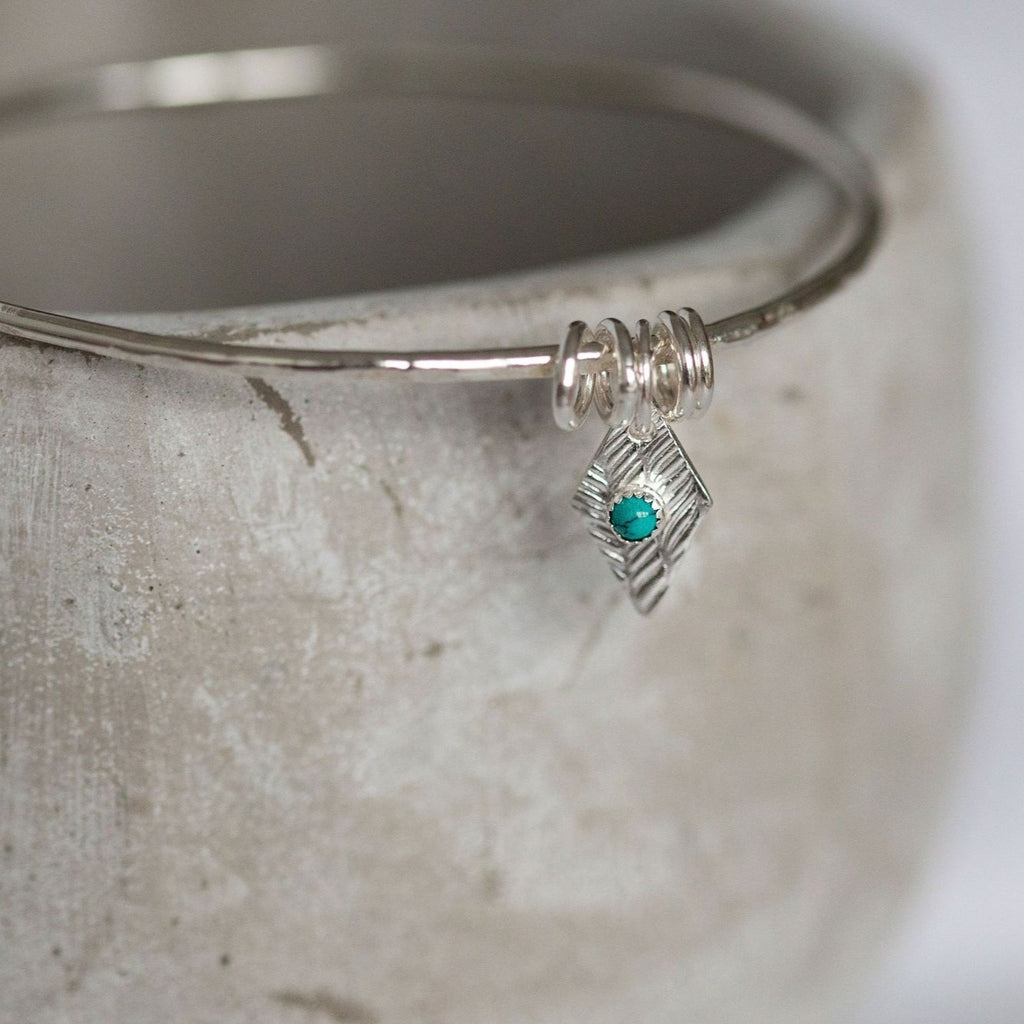 sterling silver diamond shaped charm with real turquoise stone by Lucy Kemp Jewellery handmade in Cornwall