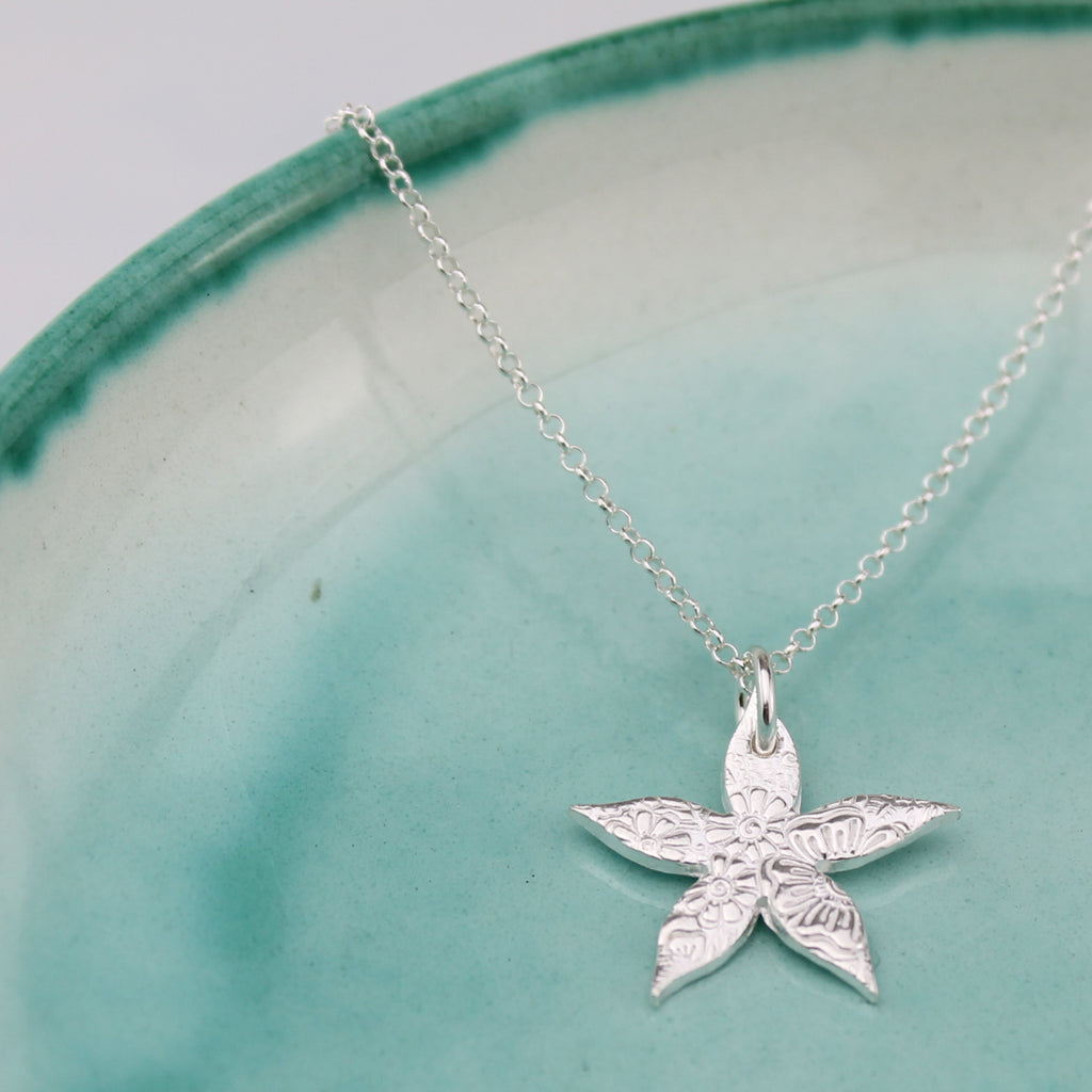 Sterling silver textured Jasmine Flower Pendant handmade by Lucy Kemp Jewellery
