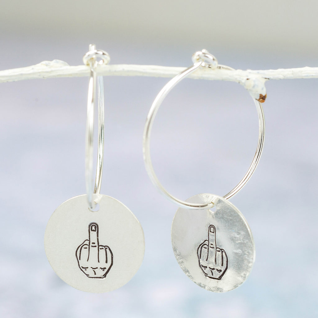 handmade sterling silver middle finger fun charm hoops by Lucy Kemp Jewellery in Cornwall