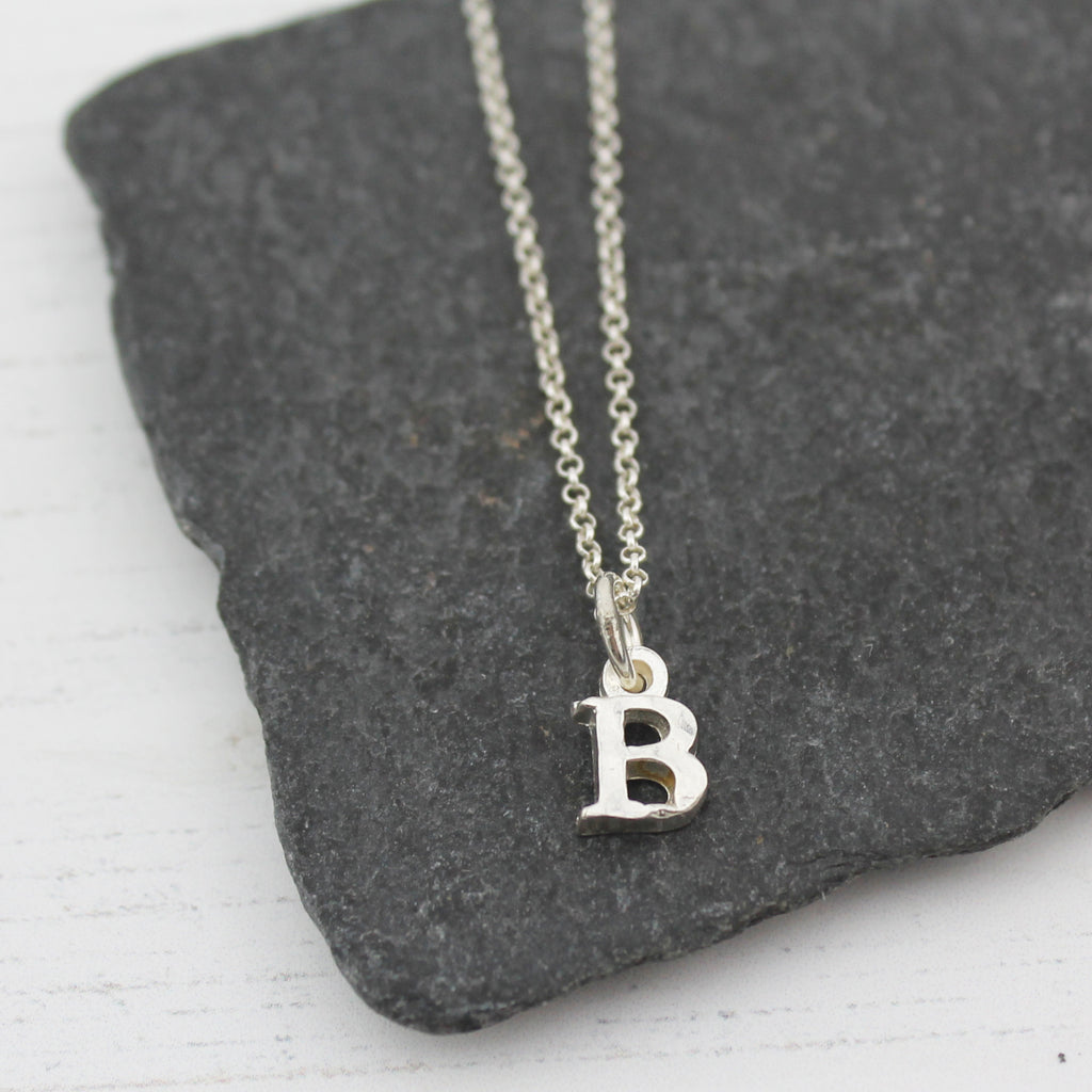 Sterling silver initial charm pendants by Lucy Kemp Jewellery