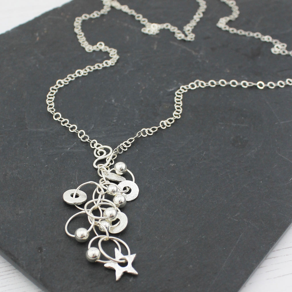 sterling silver long and really long charm necklace handmade by Lucy Kemp Jewellery