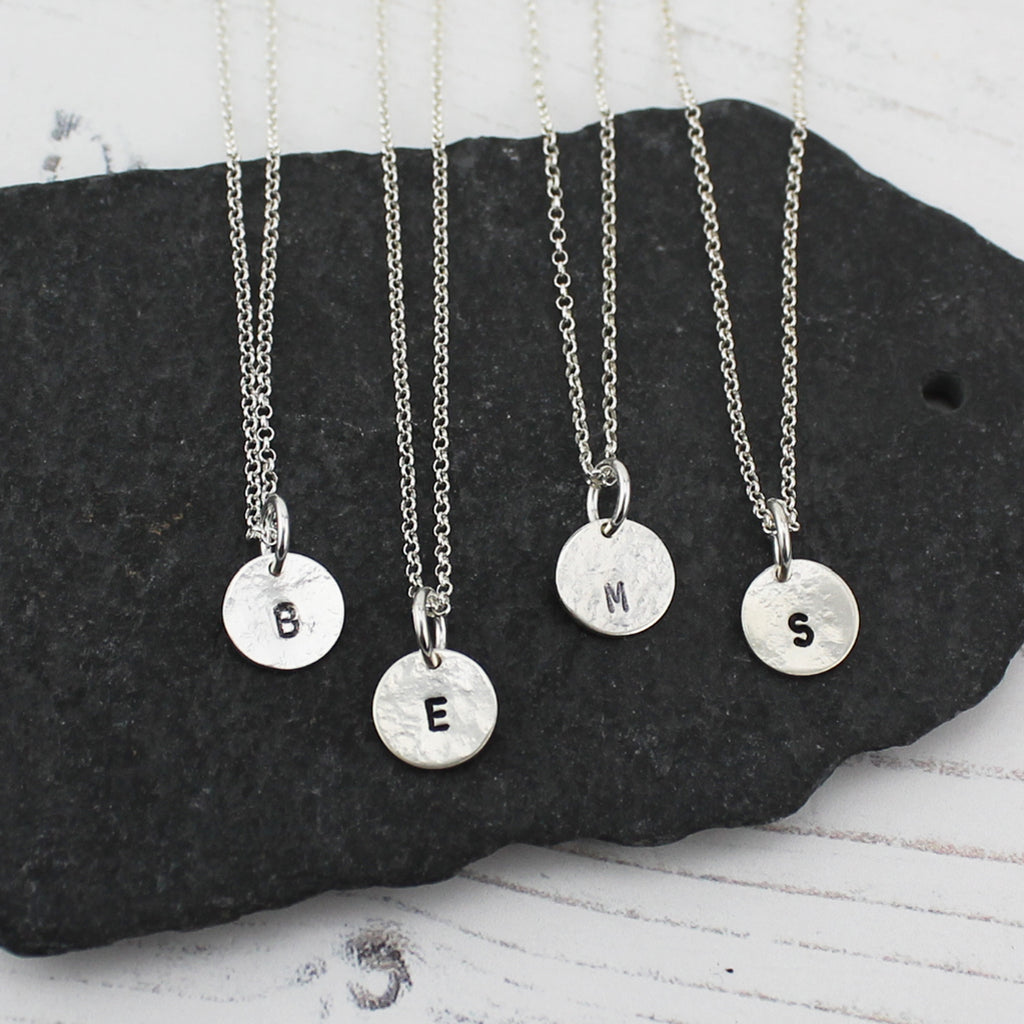 sterling silver stamped initial dinky pendant by Lucy Kemp Jewellery