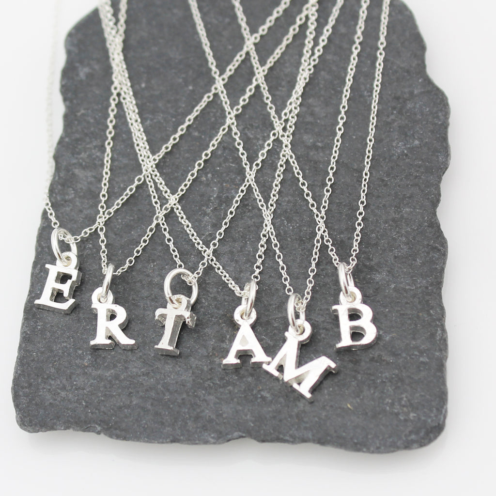 sterling silver initials charm pendant collection at Lucy Kemp Jewellery