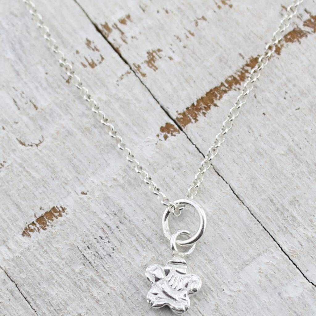 sterling silver mini flower personalised pendant by Lucy Kemp Jewellery