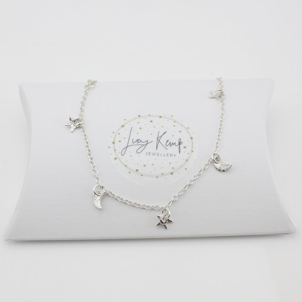 sterling silver textured star and moon charm bracelet handmade by Lucy Kemp Jewellery