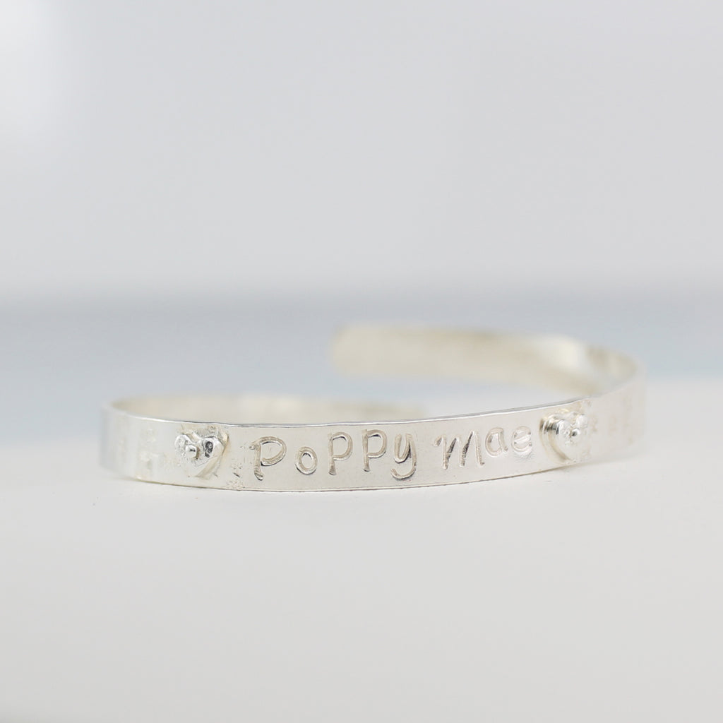 sterling silver personalised christening bangle handmade by Lucy Kemp Jewellery