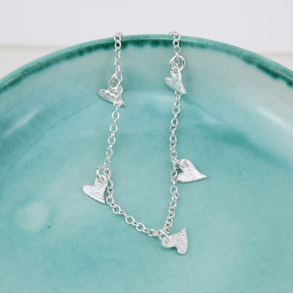 Sterling silver textured tilted heart charm bracelet handmade by Lucy Kemp Jewellery