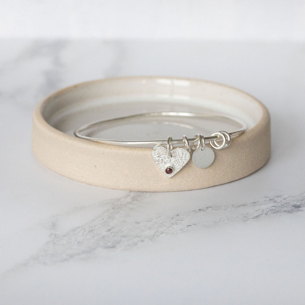Sterling silver heart birthstone bangle handmade by Lucy Kemp Jewellery