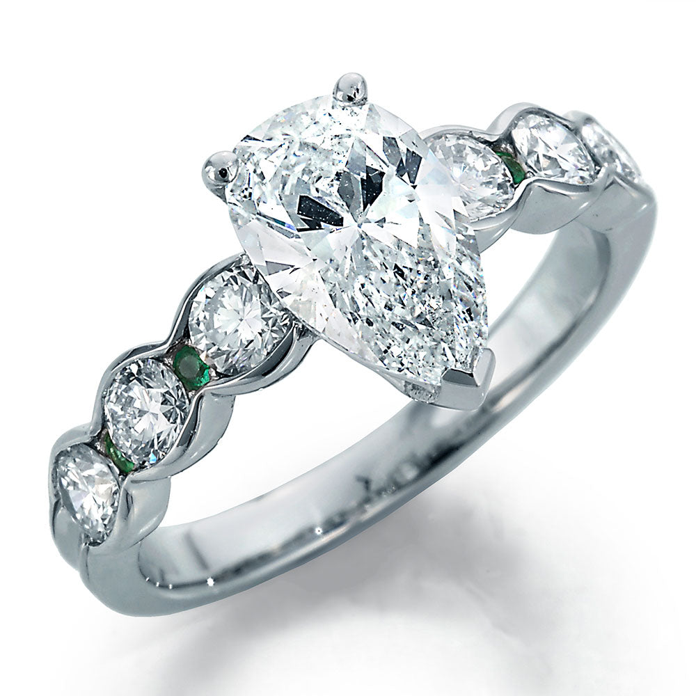 Image of Pear Shape Center with Round Diamonds and Emeralds Engagement Ring