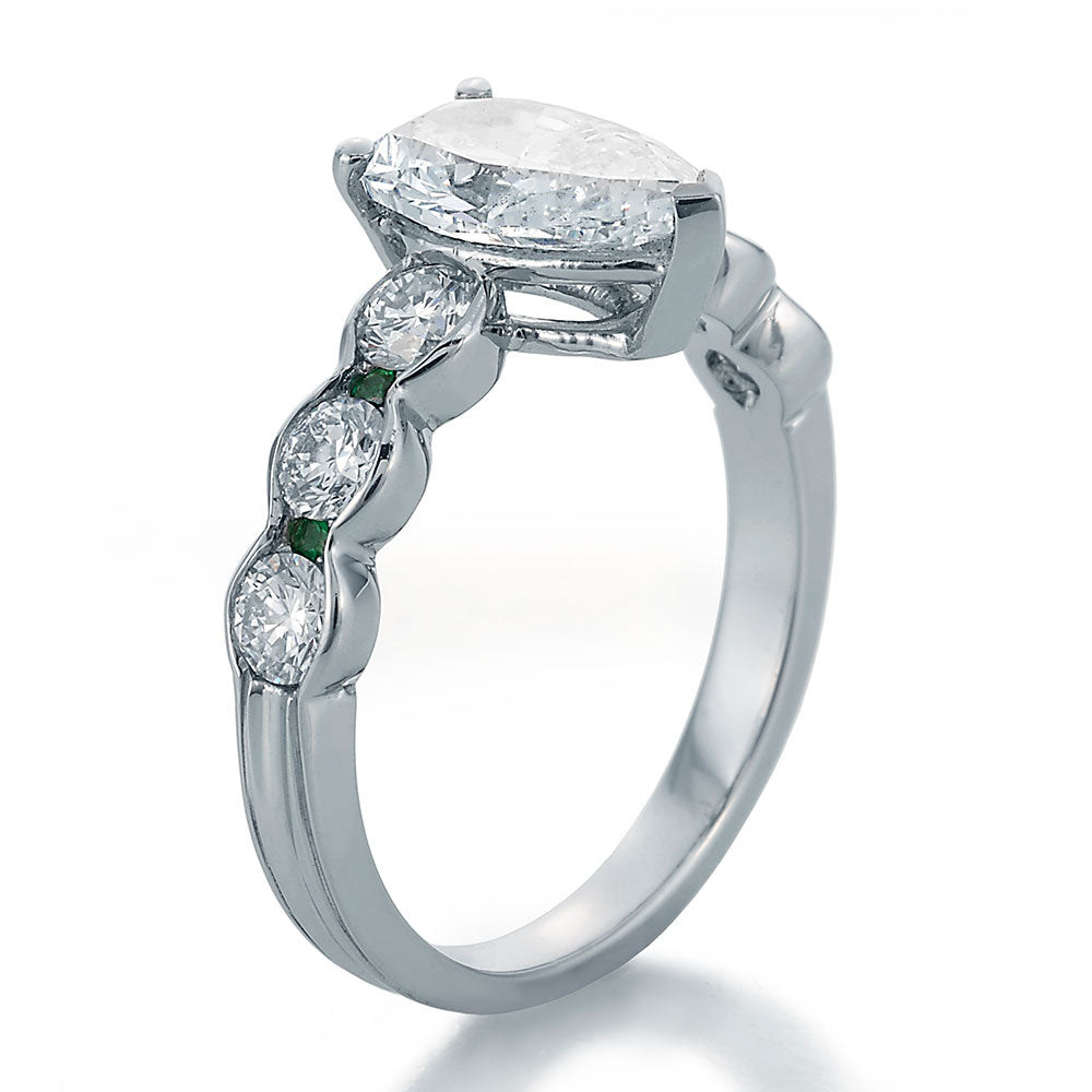 Side View Image of Pear Shape Center with Round Diamonds and Emeralds Engagement Ring