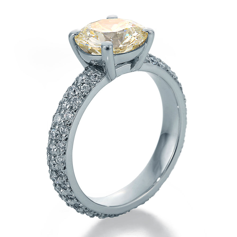 Side View Image of Engagement Ring with Chardonnay Round Center and Round Accent Diamonds