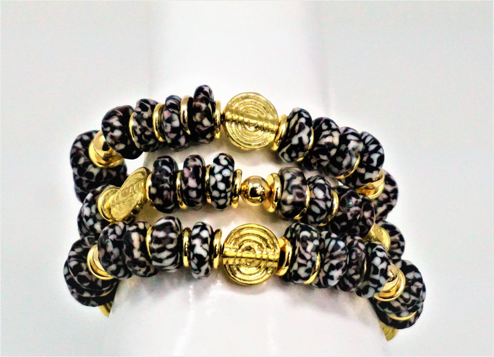 Black and White bracelets with gold accent