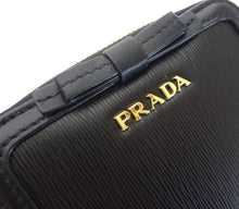 Prada Women's Black Nero Vitello Move Zip Flap Bow Wallet 1ML522 - Vancelette Global Art Acquisitions