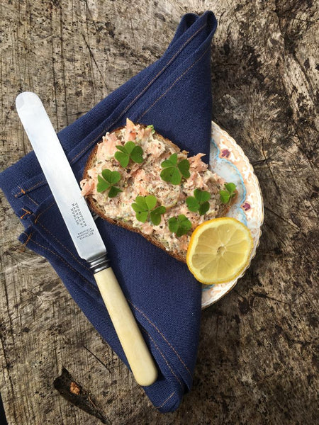 Fresh salmon open sandwich with wood sorrel, dill mayo and black pepper