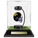 University of Iowa Hover Helmet in Acrylic Case, on top of Hover Helmets TURF, on a base with plaque