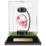 University of Nebraska Hover Helmet in Acrylic Case, on top of Hover Helmets TURF, on a base with plaque