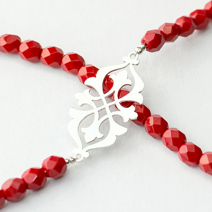 Arabesque necklace in sterling silver and red beads.