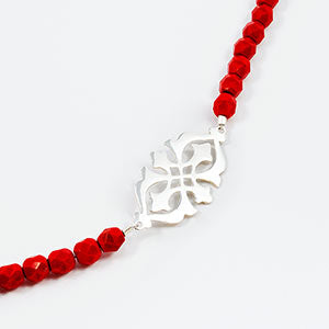 Arabesque on red beads - high res.