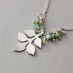 Branch and gemstone buds necklace.