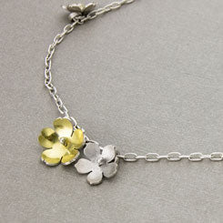 Forget-me-nots and buttercups necklace in gold and silver.