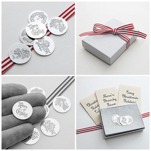 Christmas pudding coins, charms or tokens in pure silver.