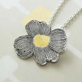 Dogwood blossom pendant in silver and gold.