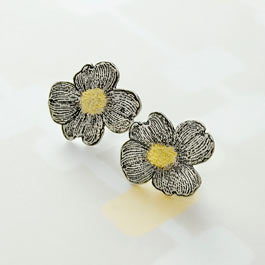 Dogwood blossom post earrings in silver and gold.