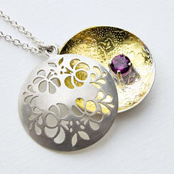Floral open locket - handmade in sterling silver, 23ct gold and a rhodolite gemstone setting.