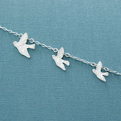 Flying birds etched necklace in sterling silver.