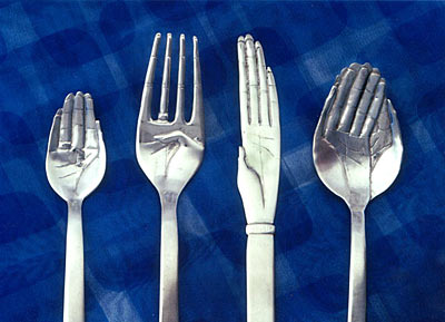Hand that Feeds cutlery in sterling silver by Simone Walsh (circa 1999)