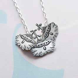 Hibiscus necklace in sterling silver.