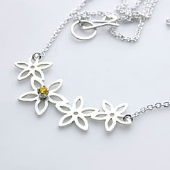 Row of daisies pendant - sterling silver and a golden topaz.