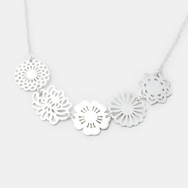 Bouquet statement necklace in sterling silver with dahlia, cherry blossom, chrysanthemum, daisy and lotus flowers by Australian jeweller Simone Walsh