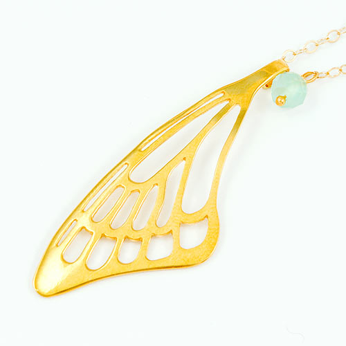 Butterfly wing pendant in gold with chalcedony gemstone