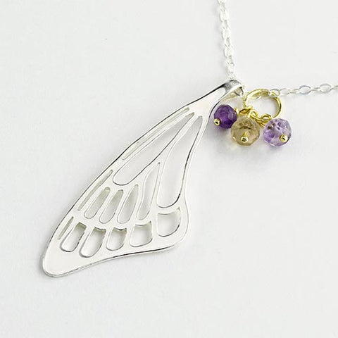 Butterfly wing pendant in sterling silver with gold and amethyst gemstones.