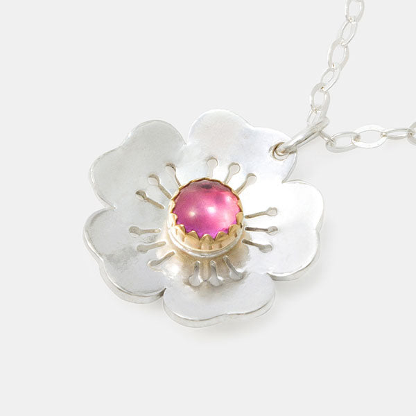 Cherry blossom pendant: sterling silver and gold with a pink sapphire gemstone. Shop in our Australian jewellery store online.