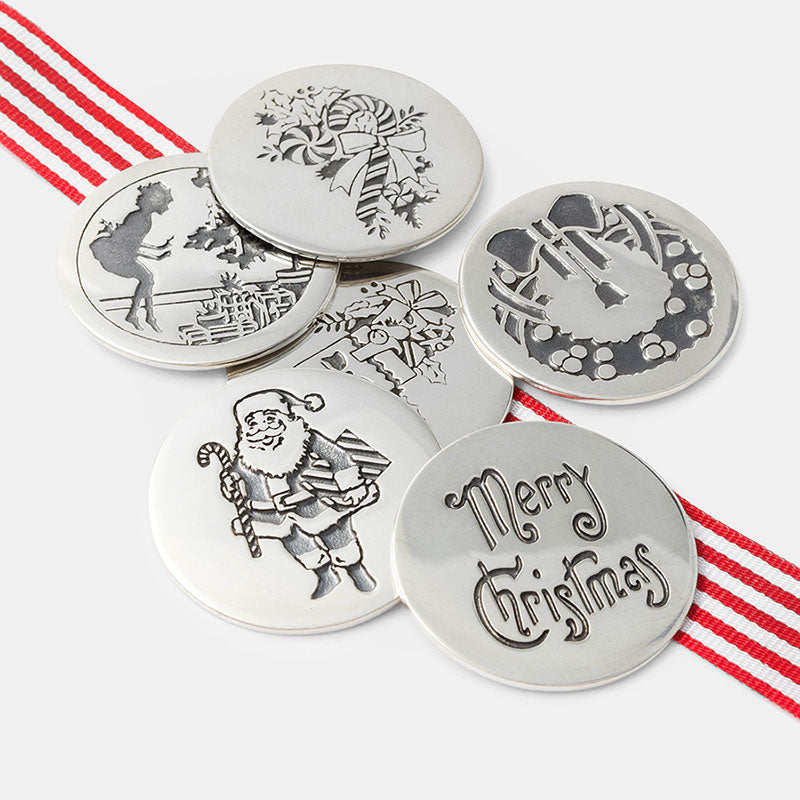 Christmas pudding coins handmade in sterling silver.