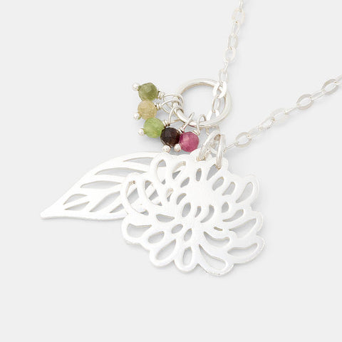 Chrysanthemum and leaf cluster pendant with tourmaline gemstones by Australian jeweller Simone Walsh.