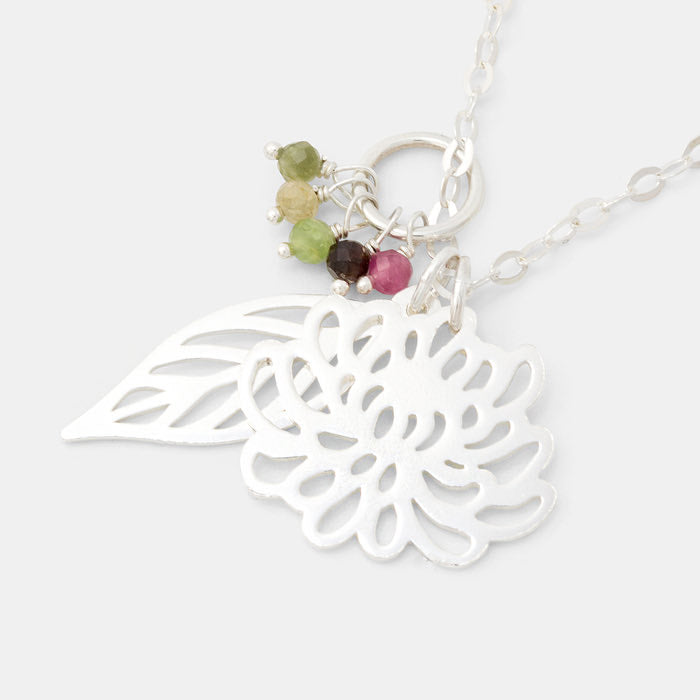 Chrysanthemum, leaf and tourmaline cluster necklace in sterling silver with tourmaline gemstones.