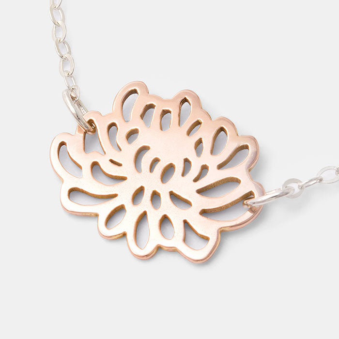 Chrysanthemum solid rose gold pendant on a sterling silver chain necklace: a unique jewellery design by Australian jeweller Simone Walsh.
