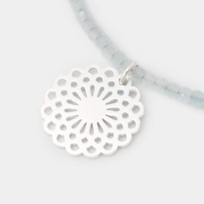 Sterling silver dahlia pendant on blue chalcedony necklace.