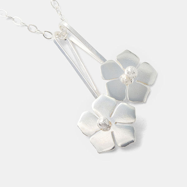 Forget-me-not flowers pendant necklace in sterling silver.