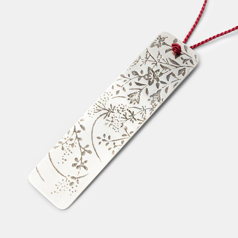 Japanese etched pendant in sterling silver on silk necklace.