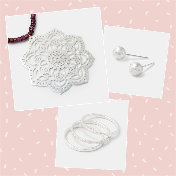 Mixed and matched sterling silver jewellery featuring a statement necklace with rose garnet gemstone beads.