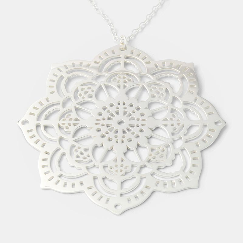 Mehndi mandala pendant made in sterling silver and available in our online Australian jewellery store.