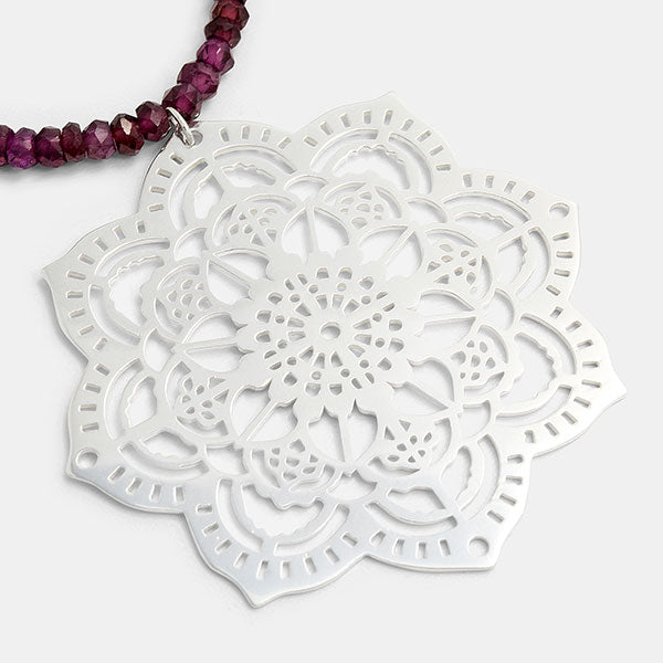 Mehndi mandala pendant with rhodolite garnet beaded necklace by Australian jeweller Simone Walsh.