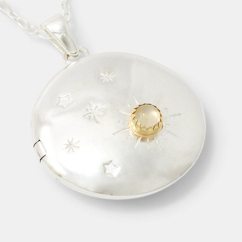 Moon and back locket necklace in sterling silver and gold.
